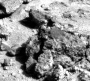 Mars human-like being. Note clothing, helmet and shoulder bag.